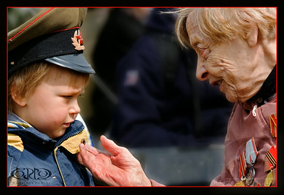 MEDALS - Moscow, Russia  A war veteran talks to a boy during a Victory Day celebration.