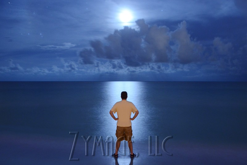 Self portrait standing in the tide on the beach watching the Crescent Moon setting over the Gulf of Mexico.