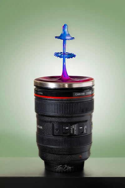 Liquid Collision on a Canon Lens.