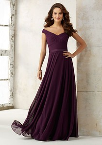 21523 Chiffon Bridesmaids Dress with Off-the-Shoulder Neckline Off-the-Shoulder Ruched Bodice and Flowy Chiffon Skirt Bridesmaids Dress Creating a Classic, Elegant Look. Zipper Back. Shown in Eggplant