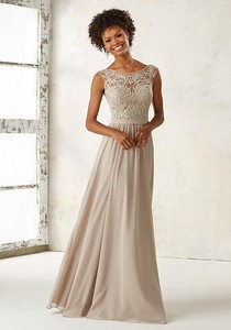 21522 Chiffon Bridesmaids Dress with Embroidery and Beading on Bodice Ornate Embroidery and Beading Accentents the Illusion Bodice on This Elegeant Chiffon Bridesmaids Dress. Open V Back with Zipper Closure. Shown in Latte