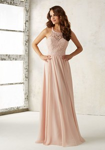 21512 Chiffon Bridesmaids Dress with Embroidery and Beading on Bodice Elaborate Embroidery and Beading Accents the Bodice of This Beautiful Chiffon Bridesmaids Dress. Criss Cross Back with Zipper Closure. Shown in Blush