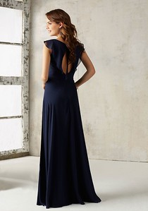 21527 Chiffon Bridesmaids Dress with V-neck and Ruffle Neckline Stunning Chiffon Bridesmaids Dress Features a Romantic Ruffled V Neckline and Open Keyhole Back. Zipper Back. Shown in Navy. Available in All Solid Chiffon Color Options.