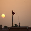 sunset over Moroccan flag
