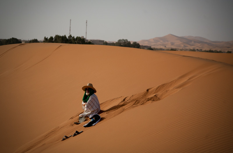 man in the Sahara sand dunes near Merzouga