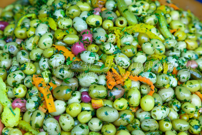 A variety of olives displayed and sold in the market of the Habous Quarter souq in Casablanca, Morocco.
