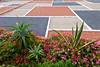 Tropical vegetation and flowers with a gravel roof pattern on the Corniche in Casablanca, Morocco.