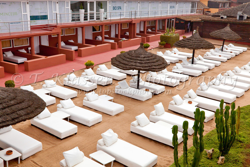 A seaside therapy Spa with white lounger beds on the Corniche in Casablanca, Morocco.