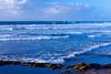 Ocean surf and waves along the Corniche seaside promenade in Casablanca, Morocco
