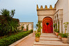A restaurant entrance with Moroccan architecture overlooking the sea in Casablanca, Morocco.
