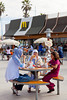 Muslim patrons eating outdoors at a seaside McDonald's restaurant on the Corniche in Casablanca, Morocco.