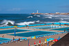 A seaside private resort on the Corniche with waves and the El Hank lighthouse in Casablanca, Morocco.