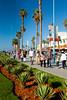 Morrocan pedestrians walk along the Corniche promenade in Casablanca, Morocco.