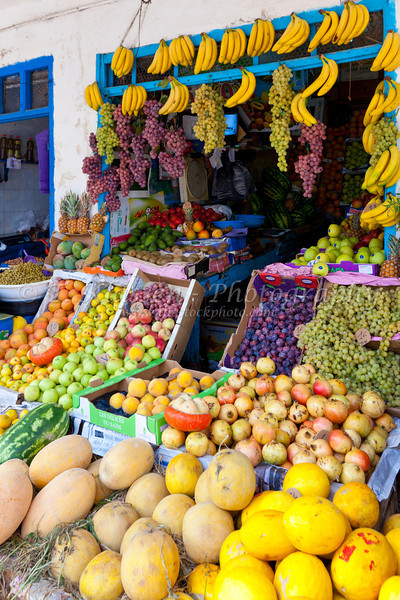 Colorful display of fruit in the shops of the souq in Essaouira, Morocco.