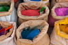 Closeup of colorful bags of pigments and dyes for sale in the souqs of Essaouira, Morocco.