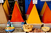 A display of pyramid shaped spices in the souq of Essaouira, Morocco.