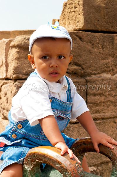 A young Arab boy posing on a canon at the Portuguese fort Modador in Essaouira, Morocco.