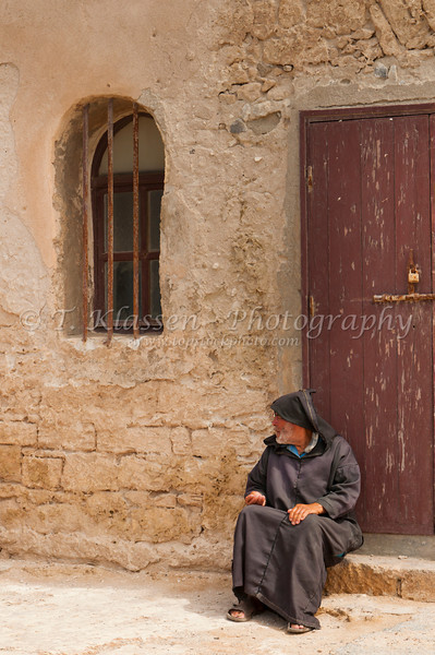 A man begging in the souqs of the medina of Essauoira, Morocco.