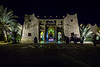 Exterior front of the Hotel Kasbah Xaluca at night in Erfoud, Morocco.