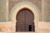Arched doorway entrance to the mosque in Meknes, Morocco.