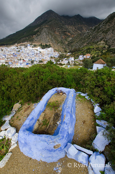 Even the graves on the hillsides around town are painted blue.