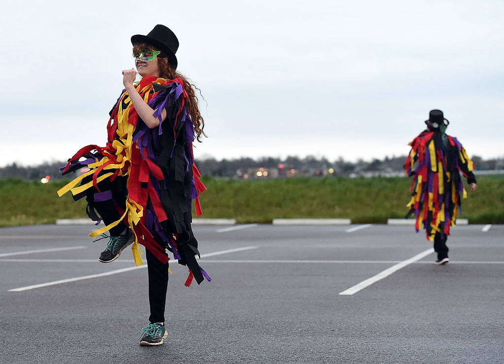. Angele Khan, 14, dances with the Breathless in Berthoud Border Morris dancers as the sun rises on Tuesday, May 1, 2018, May Day -- a tradition dating back to the 1500s -- as they celebrate traditions from the Cotswalds region on England.   (Photo by Jenny Sparks/Loveland Reporter-Herald)