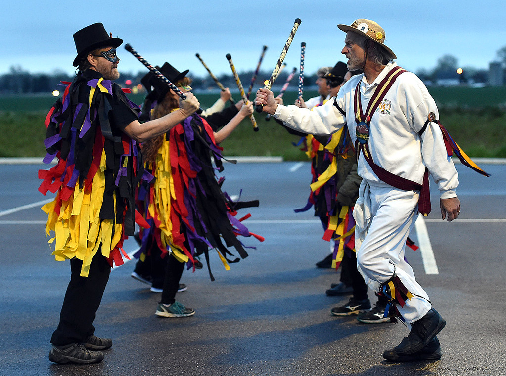 . The Breathless in Berthoud Border Morris dancers dance the sun up on Tuesday, May 1, 2018, May Day -- a tradition dating back to the 1500s -- as they celebrate traditions from the Cotswalds region on England. Up front are Ron Khan, left, and Robin Smith, right.  (Photo by Jenny Sparks/Loveland Reporter-Herald)