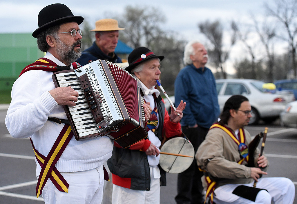 . Rodney Sauer, left, plays the accordian as Carla McKenna, center, plays the 3-hole pipe and tabor drum while Jason Shapiro, right, plays the Uilleann pipes as The Maroon Bells Morris Dancers dance as the sun rises on Tuesday, May 1, 2018, May Day -- a tradition dating back to the 1500s -- as they celebrate traditions from the Cotswalds region on England.  (Photo by Jenny Sparks/Loveland Reporter-Herald)
