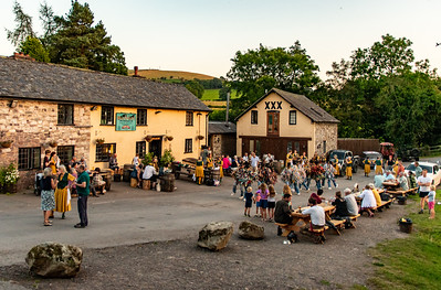 A country inn, setting sun, and dancing.