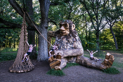 Triplets toy with the troll at the Morton Arboretum in Lisle, IL