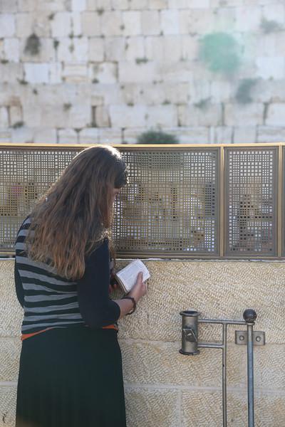 Woman praying at the Western Wall