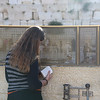 Woman praying at the Western Wall