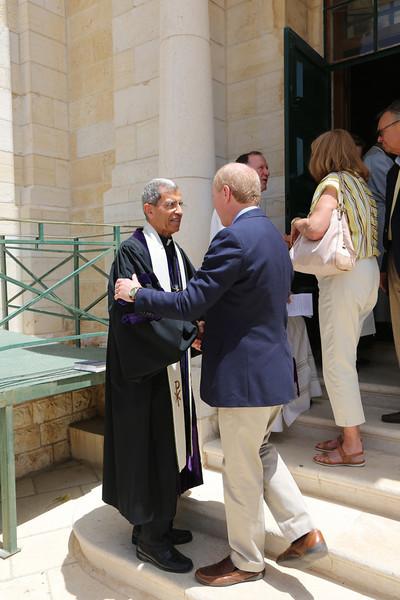 Rev. Victor Makari greets Rev. Tom Taylor
