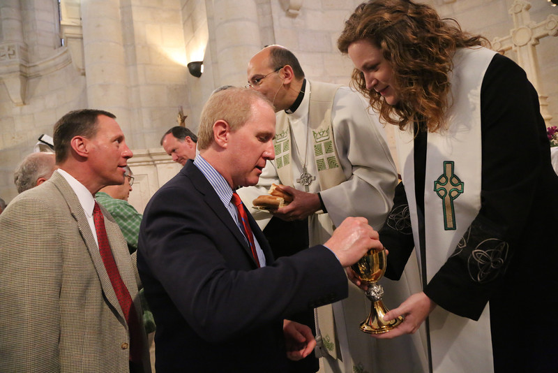 Tom Taylor receives communion from Mission Coworker Kate Taber