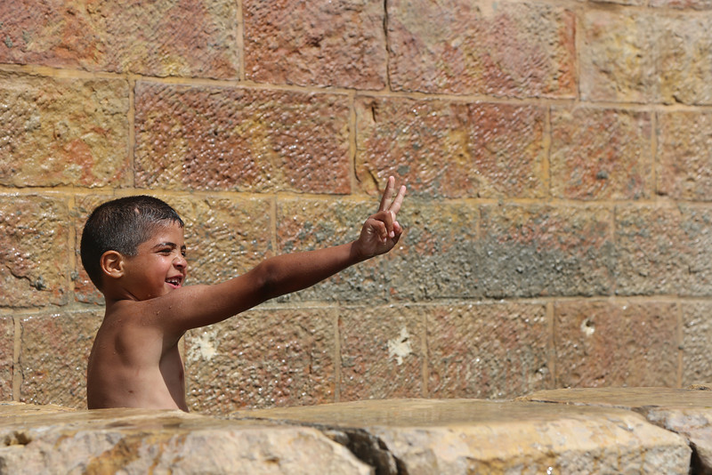 Palestinian children playing in the fresh water spring of Battir