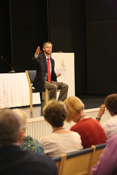 Nathan Stock from the Carter Center addresses the Mosaic of Peace Gathering