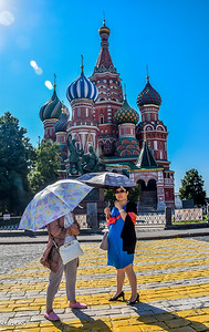 Asian ladies keeping cool in front of St Basil's Cathedral.