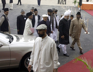 Huzur walking towards mosque entrance