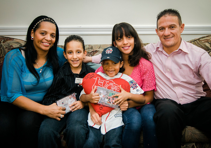 Jasmin Luzon, Erikson, Josmaily, Gemely, and Jose Cruz are all smiles in their Fitchburg home on Wednesday afternoon. Josmaily was part of a pre-game ceremony honoring David Ortiz on Sunday afternoon during his final regular season game as a member of the Boston Red Sox. Josmaily received life-saving heart surgery paid for through the David Ortiz Children's Fund in September 2014. SENTINEL & ENTERPRISE / Ashley Green