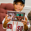 Josmaily Luzon Cruz, 6, shows off a commemorative patch given to him by David Ortiz during a pre-game ceremony held on Sunday afternoon, Ortiz's last home game as a member of the Boston Red Sox. Cruz receiving life-saving heart surgery paid for through the David Ortiz Children's Fund in September 2014. SENTINEL & ENTERPRISE / Ashley Green