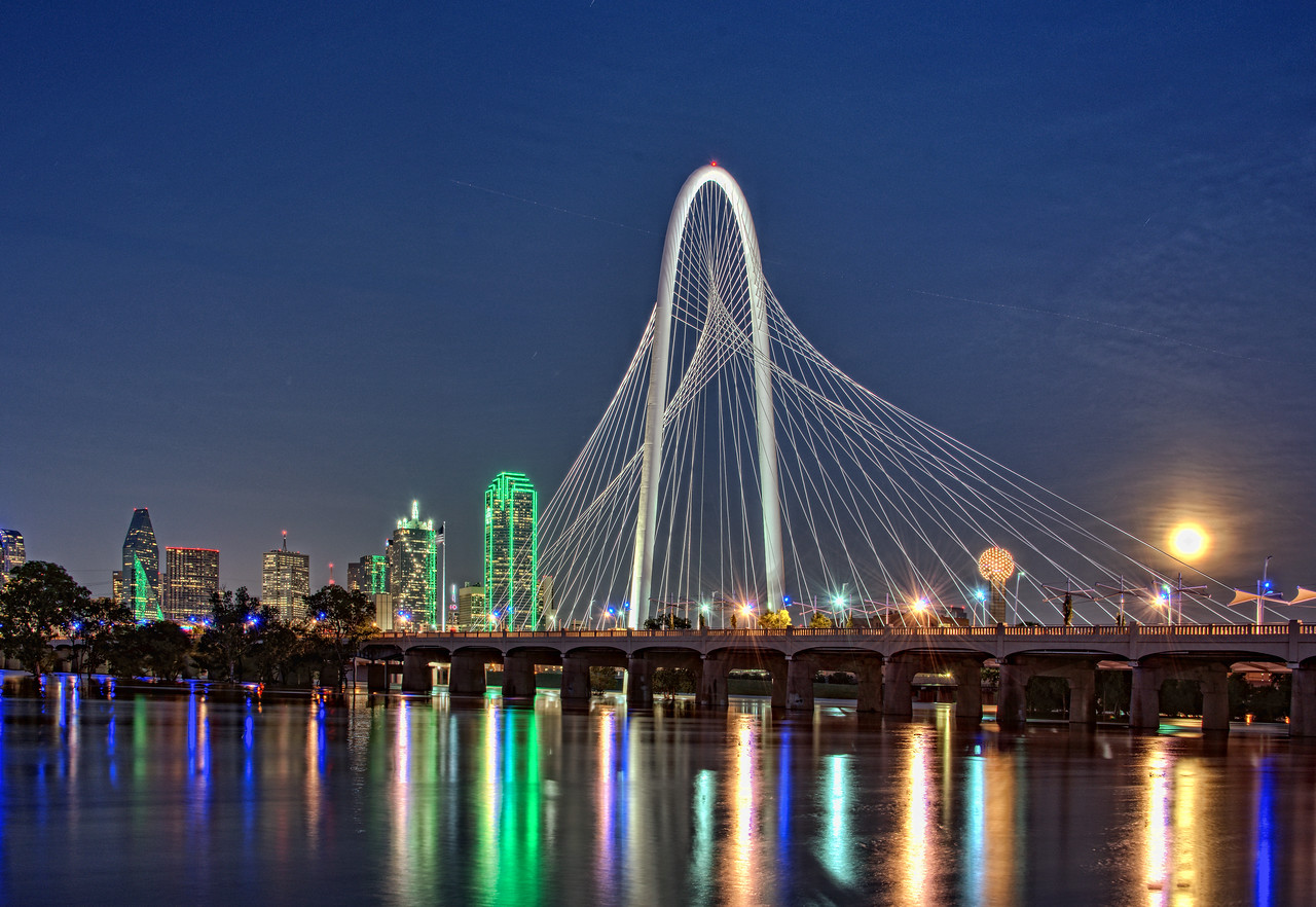 Strawberry moon rising over Dallas skyline with the entire Trinity River floodplain serving its purpose