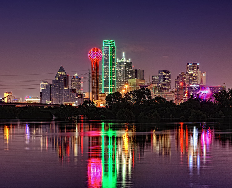 Dallas skyline with Trinity River reflection, and the Omni Hotel welcoming the Rolling Stones to Dallas