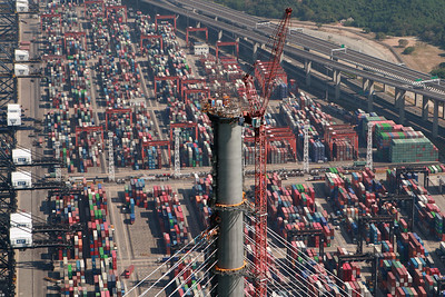 The East tower of Stonecutters Bridge, at a height of 295 metres, soars above Hong Kong's Container Terminal 8.