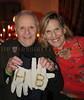 Henrt Buhl receives workers gloves engraved with his initials in gold from Susan Needles special events Director of  Development A.C.E.