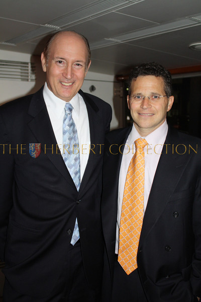 Mike Marcus and Elliot of Merril Lynch private banking enjoy the ambiance of the Forbes Yacht