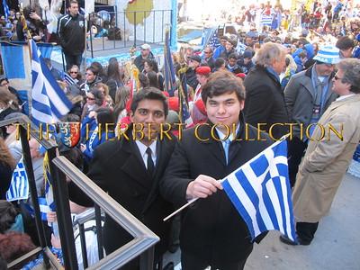 A friend celebrating the Greek American day parade with John Catsimatidis Jr.