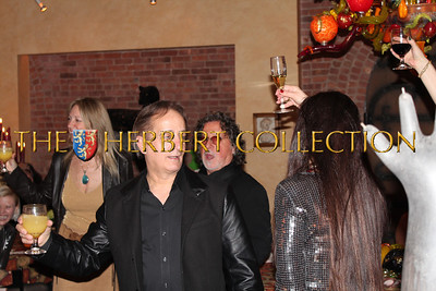 Robert Farber, James Cavallo and guests prepare for a Happy Birthday toast to Chau-Giang Thi Nguyen