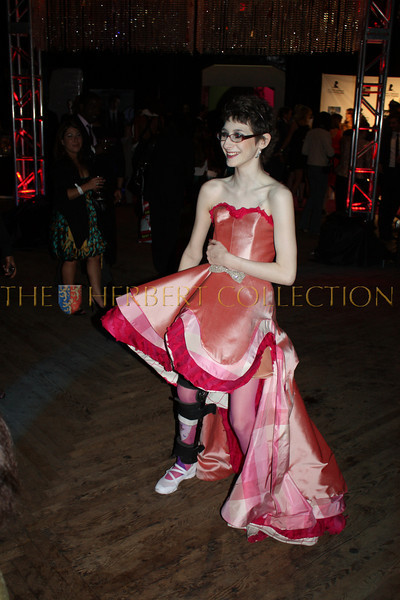 St. Jude patient Vivian and  dances after strutting the runway wearing a gown designed by Tian Justman, also a former patient
