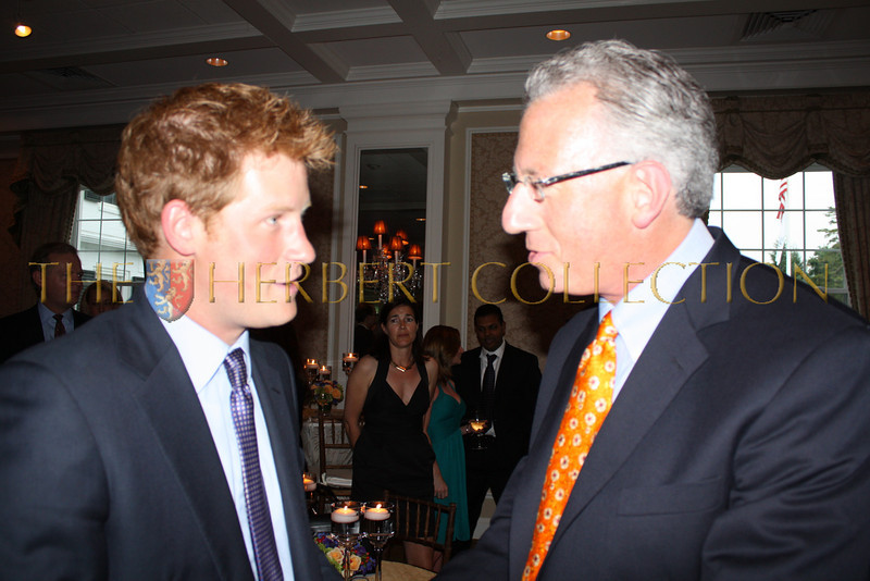 HRH Prince Harry of Wales speaks with Barry Klarberg, Monarch Management