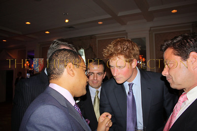 H.E. US Ambassador Francis Lorenzo of the Dominican Republic speaks with Prince Harry as host, Richard Lukaj and Ronald H. Posyton look on.